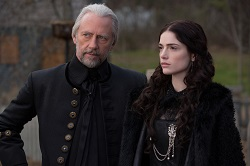 Magistrate Hale (Xander Berkeley), Mary Sibley (Janet Montgomery) discuss Salem's witch panic.