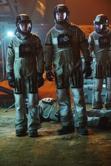 L-R: Beckett, Castle, and Esposito go inside the space module to question the other astronauts on board.