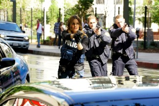 Beckett, Ryan, and Esposito corner Mike (not seen) on the street to find out what he's hiding in the trunk.