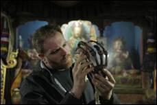 Gates examining the Pangboche Yeti hand