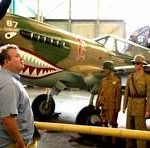 "Eric Stonestreet in The Pacific Aviation Museum in Oahu, Hawaii, for ""Celebrity Adventure Club"""